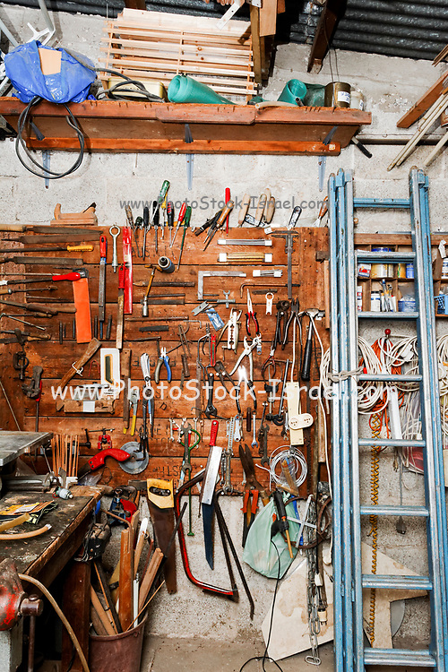 Interior of a workshop. Tools hang on a wall