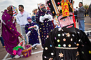 """Dec. 12, 2009 -- PHOENIX, AZ: Matachines get ready to perform during a procession to honor the Virgin of Guadalupe at St. Catherine of Siena Catholic Church in Phoenix, AZ. Most of the members of the church are Hispanic and Dec. 12, Virgin of Guadalupe Day, is one of the church's most important holy days. The Virgin of Guadalupe appeared to Juan Diego, a Mexican peasant, on Dec 9, 1531, on a hillside near Mexico City. She is the """"Queen of Mexico"""" and """"Empress of the Americas"""" and revered throughout Latin America. Matachine dancers, common in northern Mexico and Mexican-American communities in the US, dance on important religious holidays to honor and venerate God.  Photo by Jack Kurtz"""