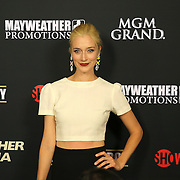 Caitlin Fitzgerald is seen on the red carpet prior to the Mayweather versus Maidana boxing match at the MGM Grand hotel on Saturday, May 3, 2014 in Las Vegas, Nevada.  (AP Photo/Alex Menendez)