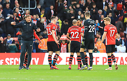 Southampton manager Ralph Hasenhuttl (left) celebrates after the final whistle with players