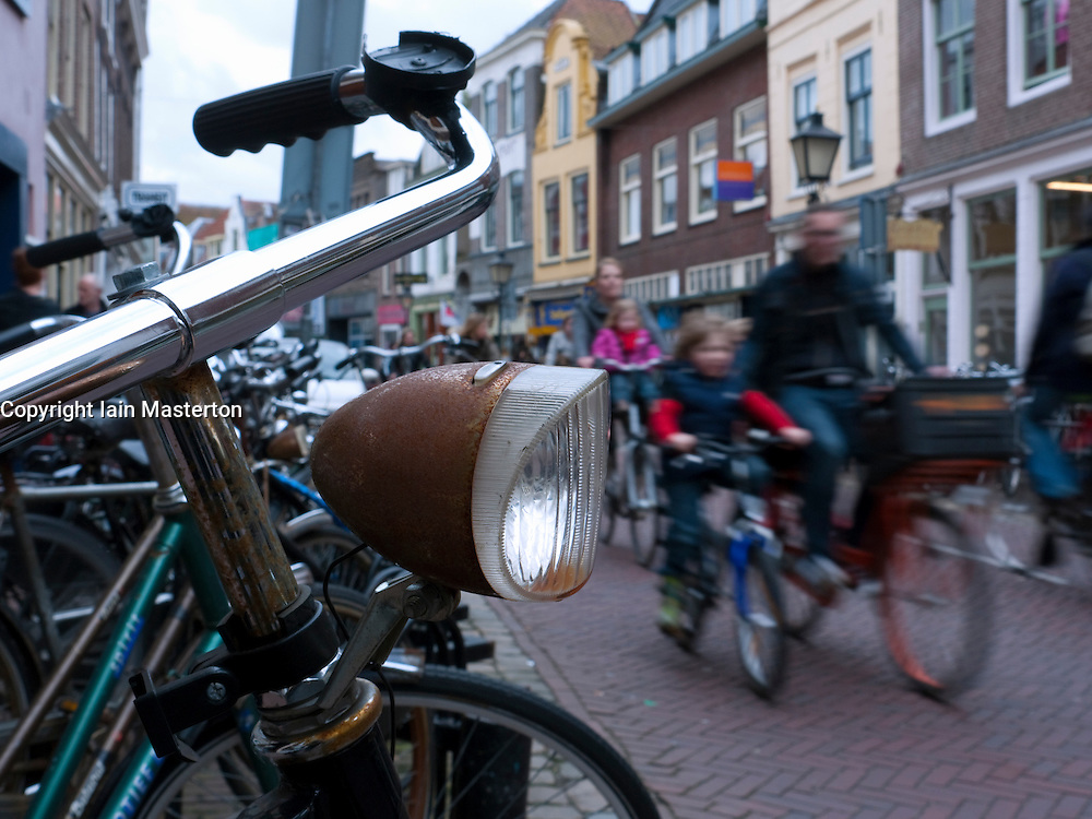 Detail of parked bicycle on street beside Oude Gracht or Old Canal in Utrecht The Netherlands