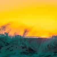 Waves wash ashore on the California coast at sunset near Pescadero, California.