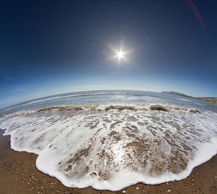 Fisheye Vertorama of Sunshine and Waves at Compton Bay