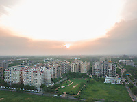 Aerial view of a residential block in dwarka sector 18A during sunset in Delhi, India.