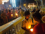 Buddhists pay tribute to their God at a little temple by the Mekong river in Phnom Penh.
