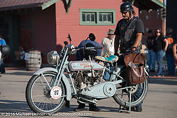 Rowdy Schenck checks out Eric Trapp's 1916 Harley-Davidson twin on display at the Dodge City finish line during the Motorcycle Cannonball Race of the Century. Stage-8 from Wichita, KS to Dodge City, KS. USA. Saturday September 17, 2016. Photography ©2016 Michael Lichter.