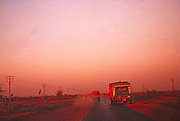 Road traffic large heavy good vehicle truck lorry evening at dusk, National highway near Karachi, Pakistan 1962