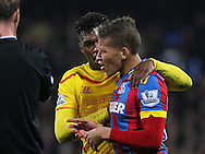 Liverpool Daniel Sturridge talks with Crystal Palace Dwight Gayle  during the The FA Cup 5th Round match between Crystal Palace and Liverpool at Selhurst Park, London, England on 14 February 2015. Photo by Phil Duncan.