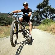 CALABASAS, CA - July 2, 2005:  Mountain biker Mark Langton rides his mountain bike while teaching a introductory mountain biking class at Malibu Creek State Park in the Santa Monica Mountains on July 2, 2005. (Photo by Todd Bigelow/Aurora)..