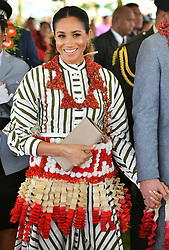 RETRANSMITTED WITH NAME OF GARMENT ADDED The Duchess of Sussex wears a ta'ovala, a traditional Tongan dress wrapped around the waist, as she visits an exhibition of handicrafts, mats and tapa cloths at the Fa'onelua Convention Centre on the second day of the royal couple's visit to Tonga.