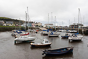Harbour in Aberaeron, Ceredigion, Wales, United Kingdom. Aberaeron is a seaside resort town, community and electoral ward in Ceredigion, Wales. Situated between Aberystwyth and Cardigan, it is home to the headquarters of Ceredigion County Council.