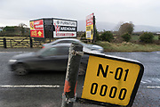 Exactly on the border crossing on the Dublin Road (Dublin to Belfast). N1 at the border of Ireland with Northern Ireland south of Newry, north of County Louth. Its the A1 Road in the north and N1 (National Primary Road) in the south. Easy to change your Euros for pounds, buy cheap petrol one side of the border, cheap drink the other. Many business exist because of the open borders. A hard border would gravely affect the economy of the border counties, and Ireland as a whole