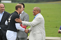 Left to right, HRH the DUKE OF CAMBRIDGE and PRINCE SEEISO OF LESOTHO at the Sentebale Polo Cup held at Coworth Park, Berkshire on 12th June 2011.