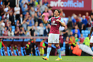 Tommy Elphick of Aston Villa , the captain, celebrates towards the fans at the end of the match. EFL Skybet championship match, Aston Villa v Rotherham Utd at Villa Park in Birmingham, The Midlands on Saturday 13th August 2016.<br /> pic by Andrew Orchard, Andrew Orchard sports photography.