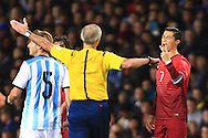 Cristiano Ronaldo of Portugal protests his innocence towards referee Martin Atkinson - Argentina vs. Portugal - International Friendly - Old Trafford - Manchester - 18/11/2014 Pic Philip Oldham/Sportimage