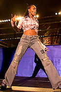 """A female Krumper on stage..Battlezone 2005 held at the Great Western Forum in Inglewood, CA. Krumpers and Clown dancers from South Central LA showcase their dancing skills in a yearly competition. Tommy Johnson, aka """"Tommy the Clown"""" started the Clown dance and Krumping movement in South Central LA as a real alternative to gangs and crime. The high energy Krumping and Clown dancing are hip hop based with African tribal dancing tributes. Face paint is often worn to distinguish the dancers unique dance styles, most are clown like with graffiti accents. The dance movement was made popular by the recent documentary """"Rize"""" by photographer David LaChappelle which featured """"Tommy The Clown"""".."""