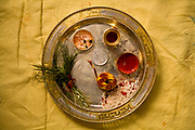 A tray containing doob grass, sandlewood, rice, coin are the elements that a bride's family use to bless a Hindu marriage, Jaipur, India.