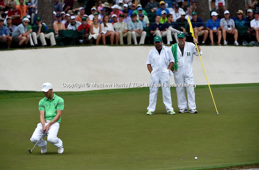 Martin KAYMER (GER) misses birdie putt at 16th par 3  during fourth round US Masters 2014,Augusta National,Augusta, Georgia,USA.