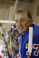 16 February 2004: Former NHL player Phil Esposito hangs over the boards to watch his teammates play in a tournament in Phoenix, AZ.