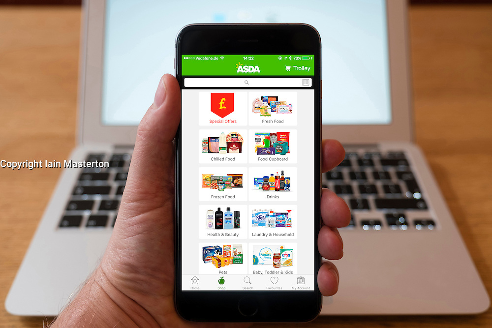 Using iPhone smartphone to display Asda online grocery shopping app