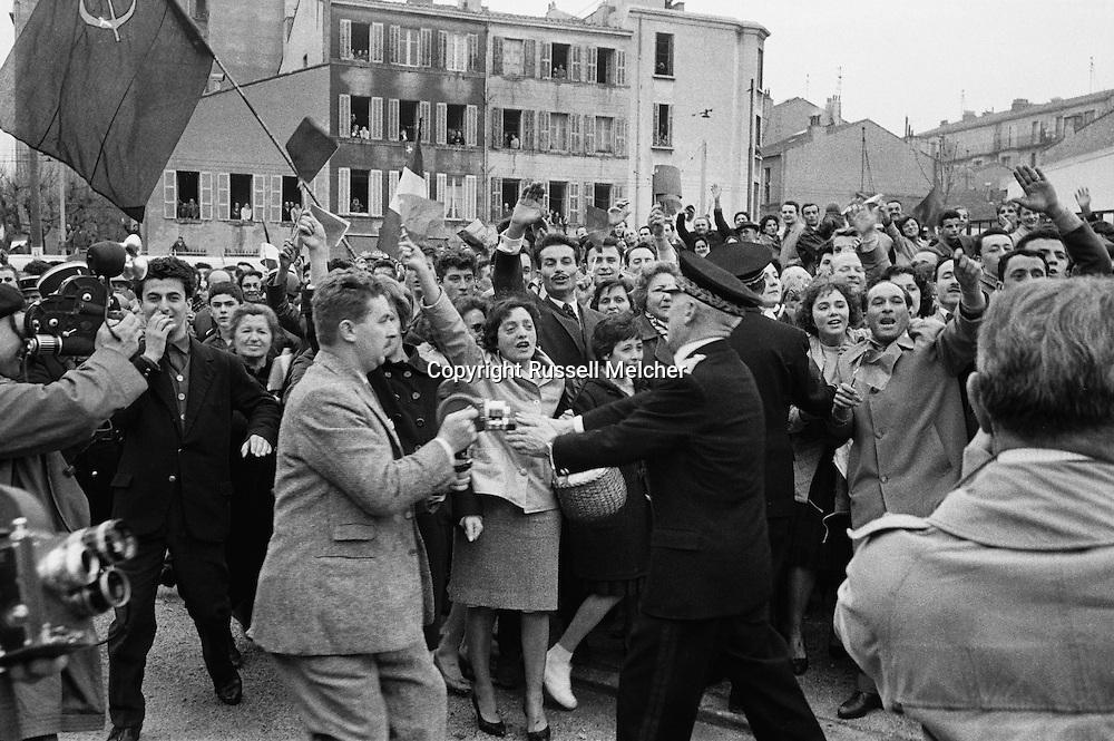 1960.Marseille,<br /> A friendly crowd of French communists<br /> breaks through security causing major<br /> panic with Khrushchev's security men<br /> as they were not prepared for a joyous outpouring such as this. They rushed Khruschev in the first car they could find and was send off. <br /> NOTE: The Russian journalists and photographers who were with us, turned around and acted as temporary bodyguards,a very unusual <br /> happening.picture 2.<br /> <br /> <br /> 1960. Marseille, France<br /> Une foule amicale des communistes français perce la sécurité causant une<br /> panique chez les hommes de la sécurité de Khrouchtchev, mal préparés pour une effusion de joie comme celle-ci . Ils ont précipités Khruschev dans la première voiture qu'ils ont pu trouver sont partis. <br /> NOTE : Les journalistes russes et les photographes qui étaient avec nous , se sont retournes et ont agis comme gardes du corps temporaires, une fonction très inhabituel pour eux.