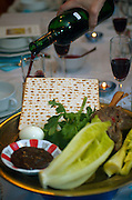 """Traditional sedder table set for a Jewish Festive meal on Passover (transliterated as Pesach or Pesah), also called chag HaMatzot - Festival of Matzot is a Jewish holiday beginning on the 15th day of Nisan, which falls in the early spring and commemorates the Exodus and freedom of the Israelites from ancient Egypt. Passover marks the """"birth"""" of the Jewish nation, as the Jews were freed from being slaves of Pharaoh and allowed to become servants of God instead."""
