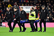 Shkodran Mustafi (20) of Arsenal is carried off on a stretcher after being injured during the The FA Cup match between Bournemouth and Arsenal at the Vitality Stadium, Bournemouth, England on 27 January 2020.
