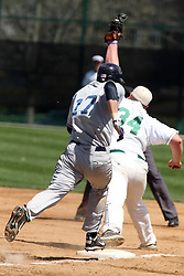 14 April 2013:  Kevin Callahan pulls in the throw that puts out Joe Kennedy during an NCAA division 3 College Conference of Illinois and Wisconsin (CCIW) Baseball game between the Elmhurst Bluejays and the Illinois Wesleyan Titans in Jack Horenberger Stadium, Bloomington IL