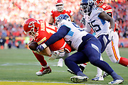 Kansas City Chiefs quarterback Patrick Mahomes (15) scrambles for a touchdown as Tennessee Titans linebacker Derick Roberson (50) and defensive back Tramaine Brock (35) defends during an NFL, AFC Championship football game Sunday, Jan. 19, 2020, in Kansas City, MO. The Chiefs won 35-24 to advance to Super Bowl 54. (AP Photo/Colin E. Braley)