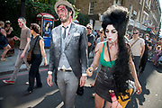 "Protester as an undead Amy Winehouse. Stoke Newington Zombie-a-thon. Hundreds of people joined together in protest in North London to demonstrate against the planned opening of a large Sainsbury's supermarket. Dressed up as zombies the protesters were making the point that they should keep local shops in the area and not have the high street ruined by large chains. The action by Stokey Local says: ""In Stoke Newington, even the dead are rising up to say 'no' to a proposed Sainsbury's development."" Walking slowly as if in a zombie film the march culminated in passing a Sainsbury's Local supermarket on the High Street. In the middle of June it was announced that a development is being planned for Wilmer Place, just beside Abney Park Cemetery on the corner of Church Street and the High Street – right in the heart of Stoke Newington. The proposed development comprises a large Sainsbury's supermarket and 44 homes and has significant implications for the diversity of the local economy, local employment, transport & traffic, noise and safety and local heritage."