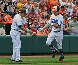 June 18, 2017 - Baltimore, MD, USA - Baltimore Orioles' Seth Smith, right, is congratulated by third base coach Bobby Dickerson, left, as he rounds the bases after his lead off home run against the St. Louis Cardinals in the first inning on Sunday, June 18, 2017 at Oriole Park at Camden Yards in Baltimore, Md. The Orioles defeated the Cardinals, 8-5. (Credit Image: © Kenneth K. Lam/TNS via ZUMA Wire)