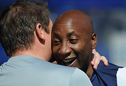 Newcastle United Manager, John Carver shares a joke with Queens Park Rangers Manager, Chris Ramsey - Photo mandatory by-line: Dougie Allward/JMP - Mobile: 07966 386802 - 16/05/2015 - SPORT - football - London - Loftus Road - QPR v Newcastle United - Barclays Premier League