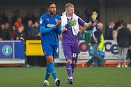 AFC Wimbledon goalkeeper Aaron Ramsdale (35) gesturing to fans and AFC Wimbledon defender Terell Thomas (6) clapping during the EFL Sky Bet League 1 match between AFC Wimbledon and Gillingham at the Cherry Red Records Stadium, Kingston, England on 23 March 2019.