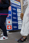 A foreign currency conversion sign in the capitals tourist area of Covent Garden, on 1st September 2017, in London, England.