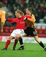 Bo Henriksen (Kidderminster). Mark Clyde (Wolves).  Kidderminster v Wolverhampton Wanderers. FA Cup 3th rd. 3/1/2004. Credit : Colorsport/Andrew Cowie.