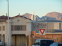 Corbett building and graffiti with Catalina Mountains