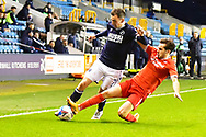 Millwall midfielder Jed Wallace (7)  and Nottingham Forest Defender Yuri Ribeiro (5) battles for possession during the EFL Sky Bet Championship match between Millwall and Nottingham Forest at The Den, London, England on 19 December 2020.