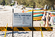 Sydney, Australia. Tuesday 19th May 2020. Rose Bay Foreshore Beach Covid 19 warning sign in Sydney's eastern suburbs. Coronavius restrictions have been eased but beaches are open for swim and go and exercise only. Sunbathing or resting on the beach, before or after you swim or exercise, are not allowed. Credit Paul Lovelace/Alamy Live News