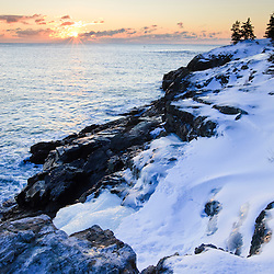 Sunrise over the Atlantic Ocean in winter as seen from near Schooner Head on Maine's Acadia National Park.