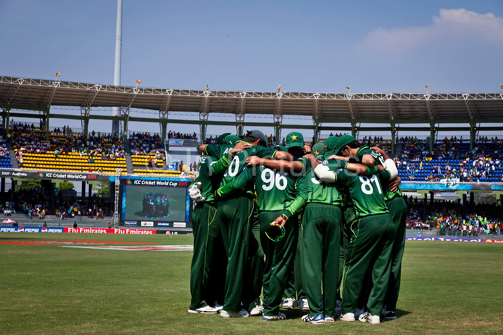 The Pakistan 2011 World Cup Cricket squad  create a huck on the pitch as they await the arrival of the Australian team in their group stage match, Premadasa Stadium, Colombo, Sri Lanka.