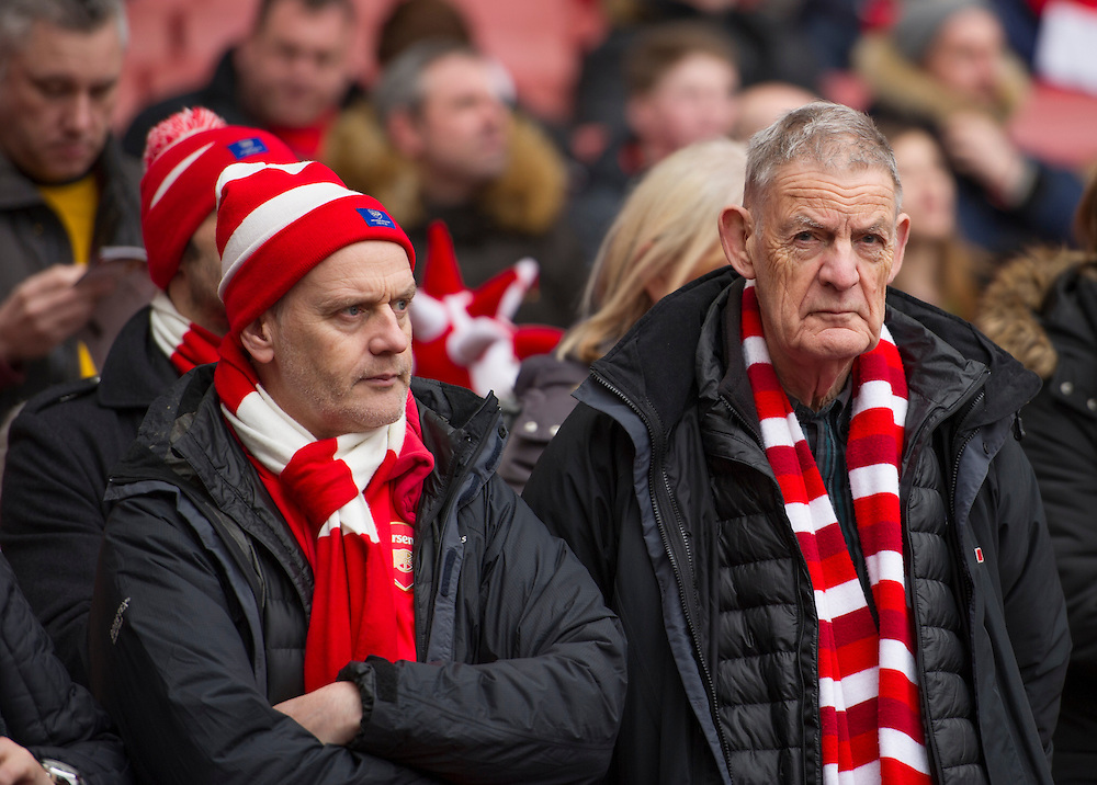 Arsenal fans dejected during the Hull City game<br /> <br /> Photographer Ashley Western/CameraSport<br /> <br /> Football - The FA Cup Fifth Round - Arsenal v Hull City - Saturday 20th February 2016 - Emirates Stadium - London<br /> <br /> © CameraSport - 43 Linden Ave. Countesthorpe. Leicester. England. LE8 5PG - Tel: +44 (0) 116 277 4147 - admin@camerasport.com - www.camerasport.com