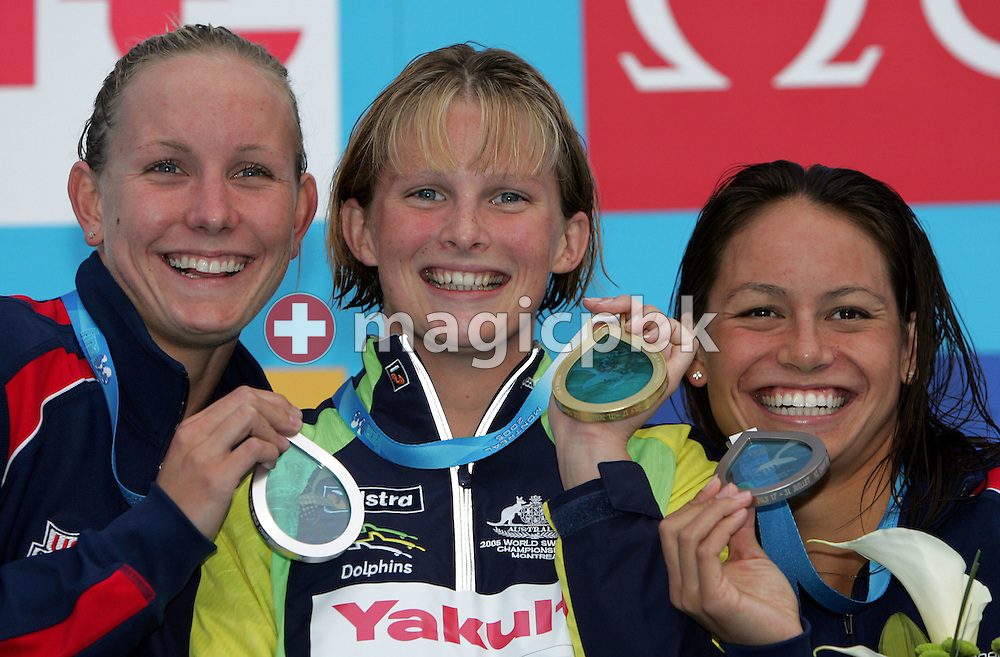(L-R) USA's Jessica Hardy, Australia's Leisel Jones and USA's Tara Kirk celebrate on the victory stand after the women's 100m Breaststroke at the FINA World Championships in Montreal, Canada Tuesday 26 July, 2005.  Leisel took the gold, Hardy took the silver and Kirk took the bronze. (Photo by Patrick B. Kraemer / MAGICPBK)