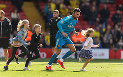 Watford's Ben Foster plays with his children after the Premier League match at Vicarage Road, Watford.