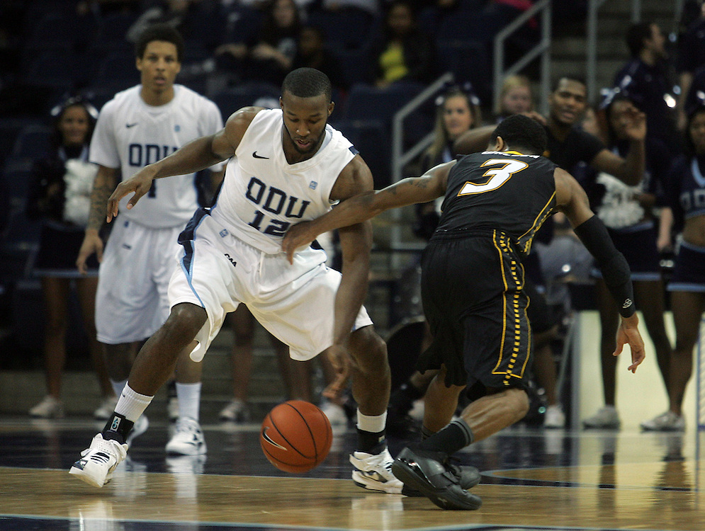 Jan 7, 2012; Norfolk, VA, USA; Old Dominion Monarchs guard Donte Hill (12) steals the ball from Towson Tigers guard Kris Walden (3) at the Ted Constant Convocation Center. Mandatory Credit: Peter Casey-US PRESSWIRE