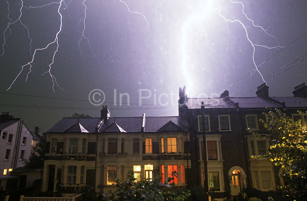 A lightning bolt spreads across night skies over South London terraced homes. Lightning is an atmospheric discharge of electricity accompanied by thunder, which typically occurs during thunderstorms, and sometimes during volcanic eruptions or dust storms. In the atmospheric electrical discharge, a leader of a bolt of lightning can travel at speeds of 220,000 km/h (140,000 mph), and can reach temperatures approaching 30,000 °C (54,000 °F), hot enough to fuse silica sand into glass channels known as fulgurites which are normally hollow and can extend some distance into the ground. There are some 16 million lightning storms in the world every year.