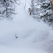 Tanner Flannagan hits deep blower powder during a monsterous storm cycle at Jackson Hole Mountain Resort in Teton Village, Wyoming.