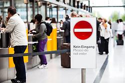 THEMENBILD - Airport Muenchen, Franz Josef Strauß (IATA: MUC, ICAO: EDDM), Der Flughafen Muenchen zählt zu den groessten Drehkreuzen Europas, rund 100 Fluggesellschaften verbinden ihn mit 230 Zielen in 70 Laendern, im Bild wartende Passagiere, Hinweisschild Kein Eingang // THEME IMAGE, FEATURE - Airport Munich, Franz Josef Strauss (IATA: MUC, ICAO: EDDM), The airport Munich is one of the largest hubs in Europe, approximately 100 airlines connect it to 230 destinations in 70 countries. picture shows: waiting passengers, Please do not enter sign, Munich, Germany on 2012/05/06. EXPA Pictures © 2012, PhotoCredit: EXPA/ Juergen Feichter