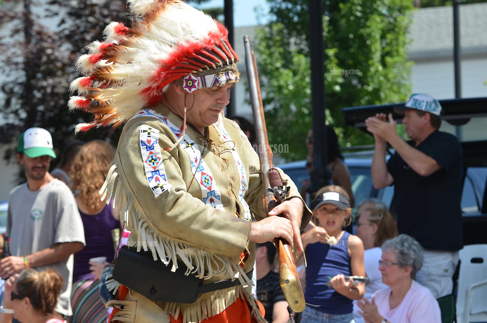 Deep River Ancient Muster 16 July 2011 in Deep River CT. 58th Annual Event, Parade on Main Street & Awards Presentations at Devitt Field. Re-enactor with Indian Garb & Rifle.