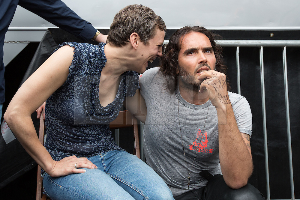© Licensed to London News Pictures . 20/06/2015 . London , UK . FRANCESCA MARINEZ and RUSSELL BRAND speaking in Parliament Square . Tens of thousands of people march from the Bank of England to Parliament , to protest economic austerity in Britain . Photo credit: Joel Goodman/LNP