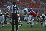 Mississippi Rebels defensive tackle Robert Nkemdiche (5) tackles Vanderbilt Commodores Rivers at Vaught-Hemingway Stadium at Ole Miss in Oxford, Miss. on Saturday, September 26, 2015. (AP Photo/Oxford Eagle, Bruce Newman)